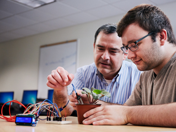 student and professor working together on project