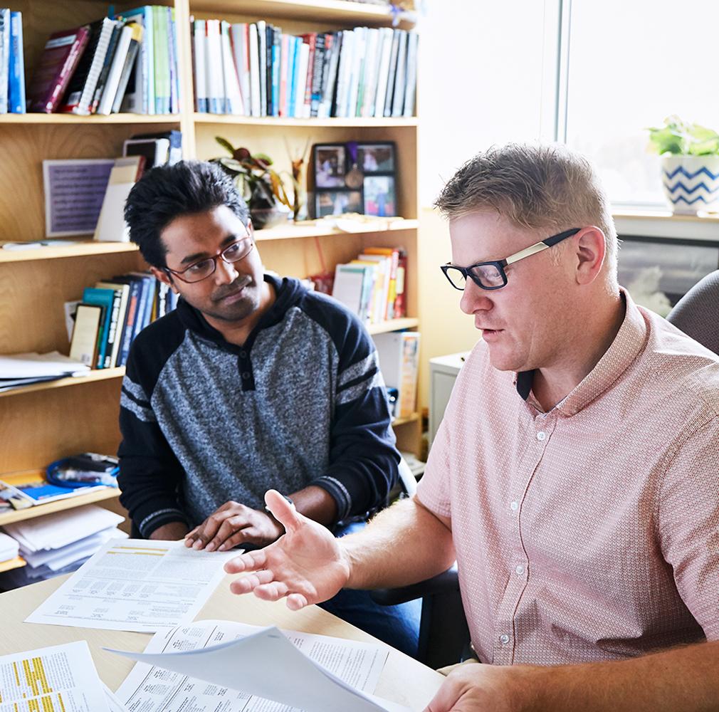 student and professor conversing