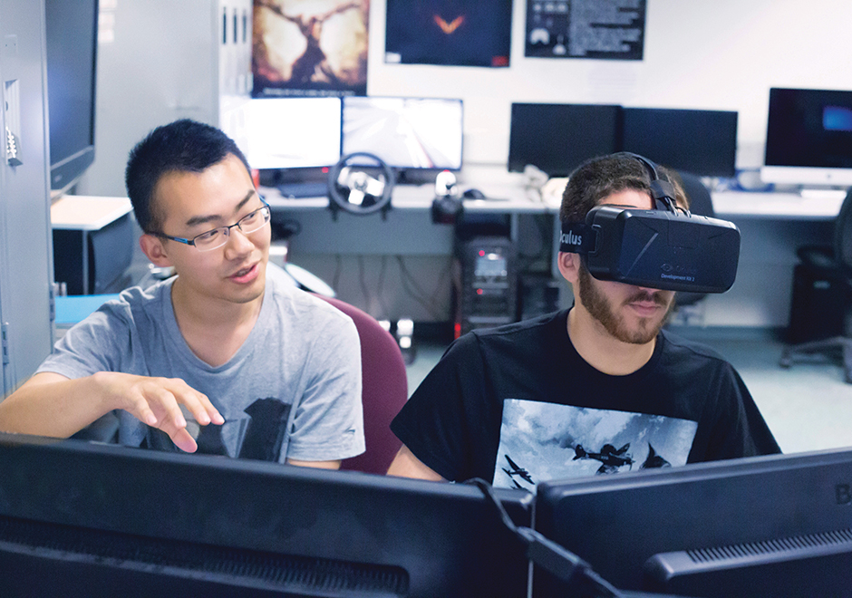students in computer lab wearing vr headset
