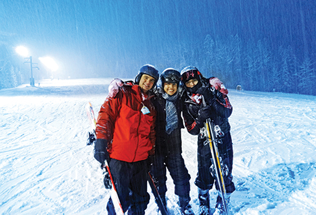 students skiing at night