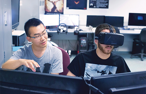 computer science students using virtual reality goggles