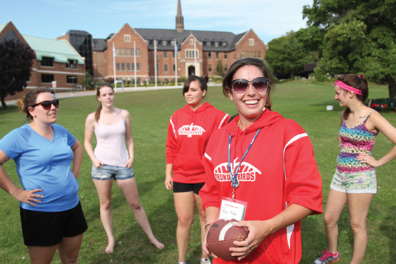 students playing games in the front lawn of Shingwauk hall