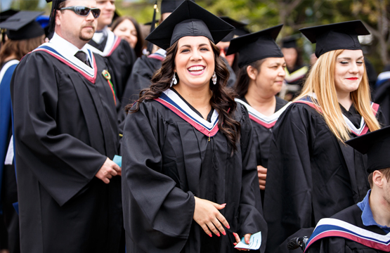 student in regalia during convocation