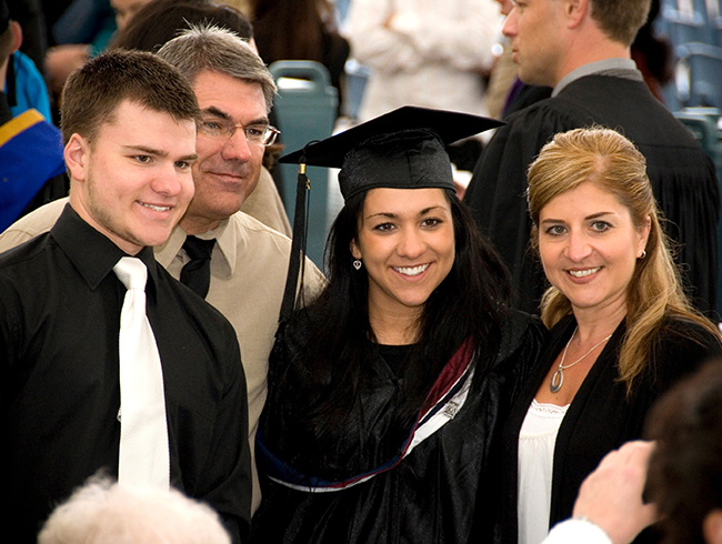 student and family at graduation