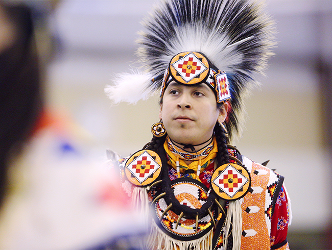 anishinaabe student in traditional garments