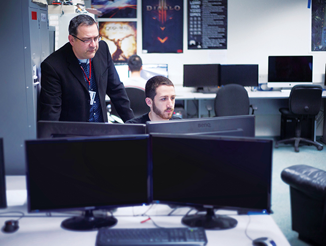 professor helping student in computer lab