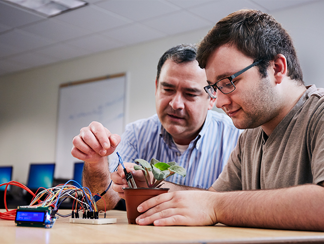 student and professor working together
