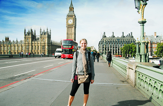 student standing on bridge in England studying abroad