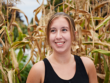 student in corn field