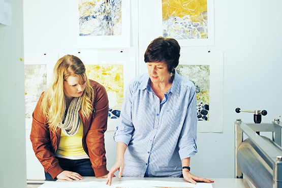 student and professor conversing in printmaking studio