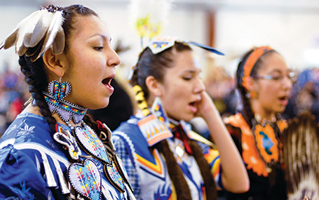 anishinaabe students in traditional garments