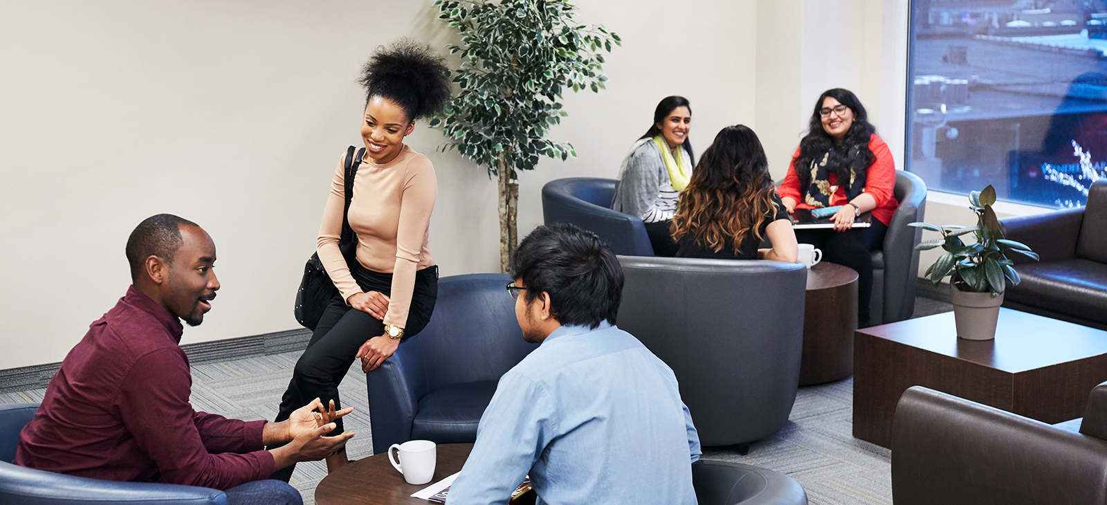 students conversing at brampton campus