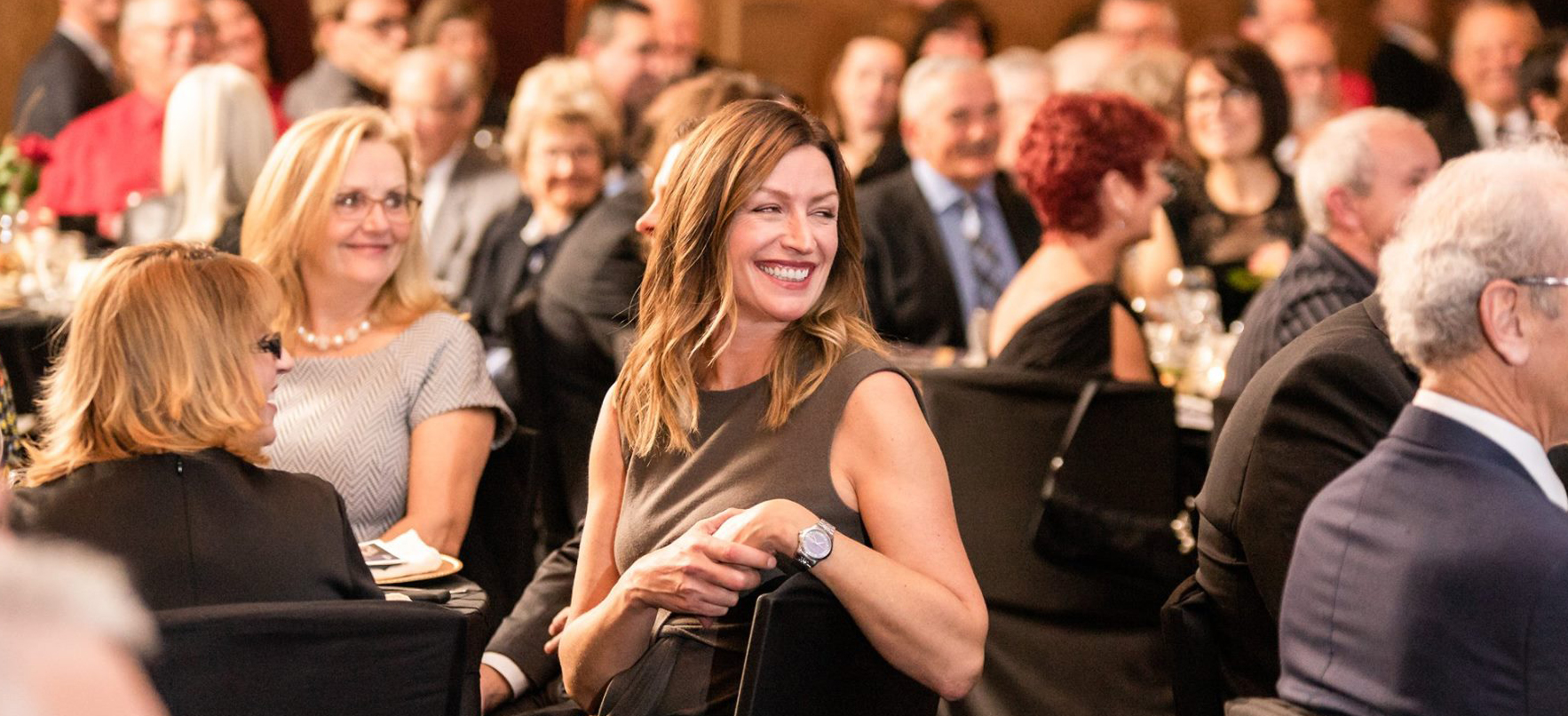 Picture of woman smiling at John Rhodes dinner
