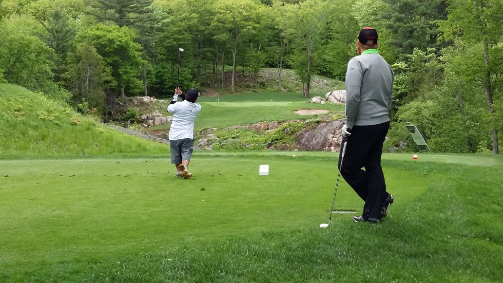 two people golfing