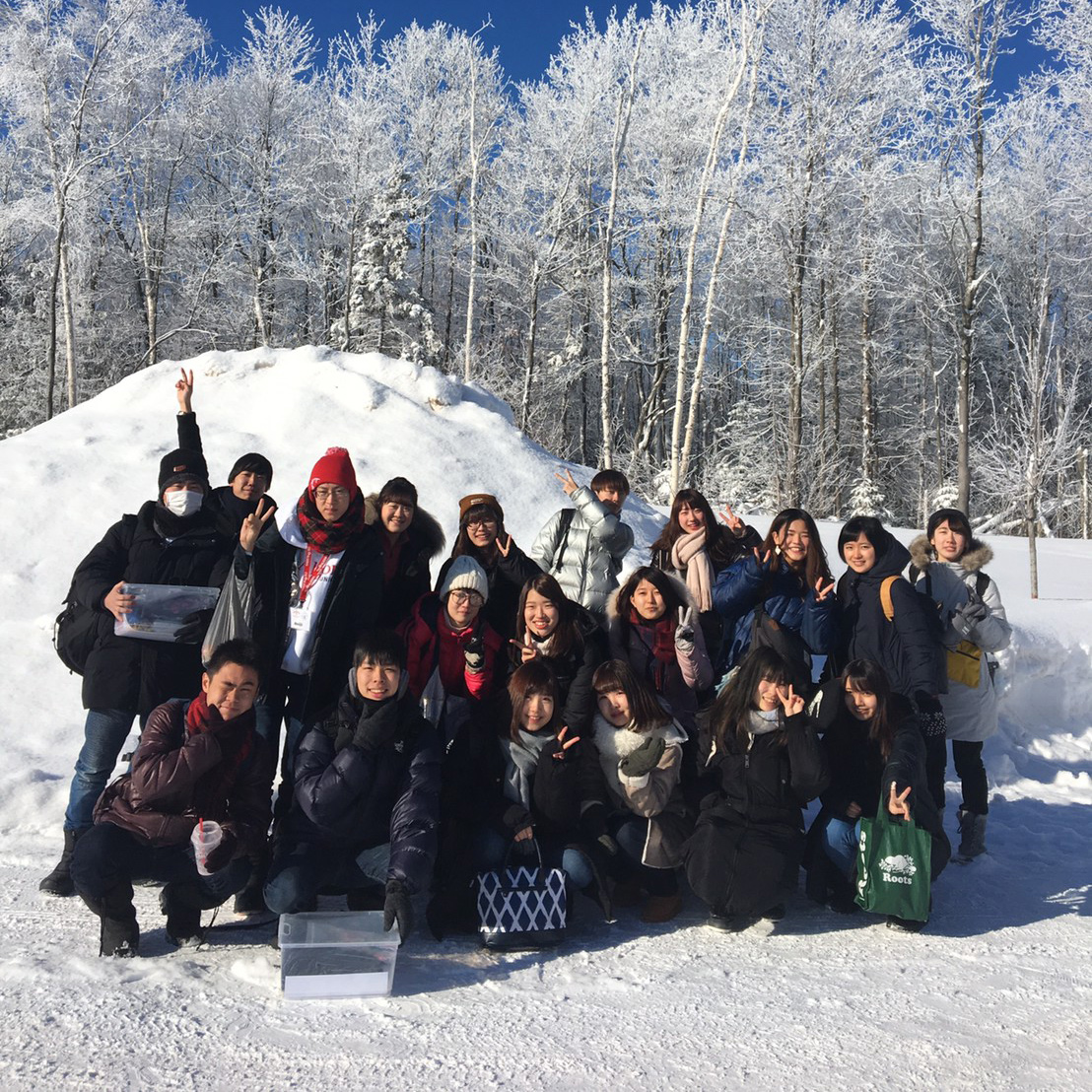 group of students posing for photo in snow