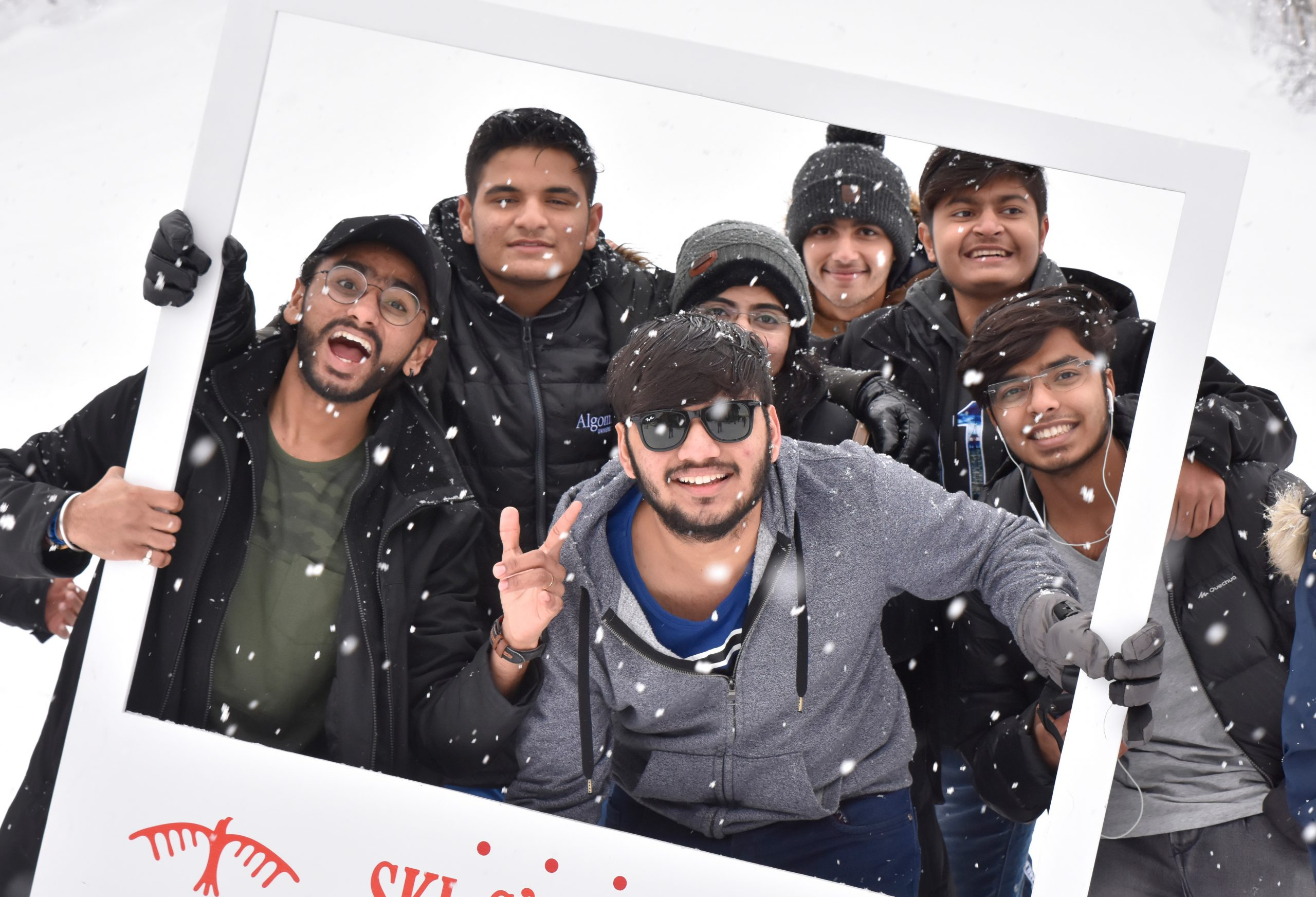 students posing for a group photo in winter